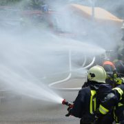firefighters taking fire under control thanks to fire resistant paint