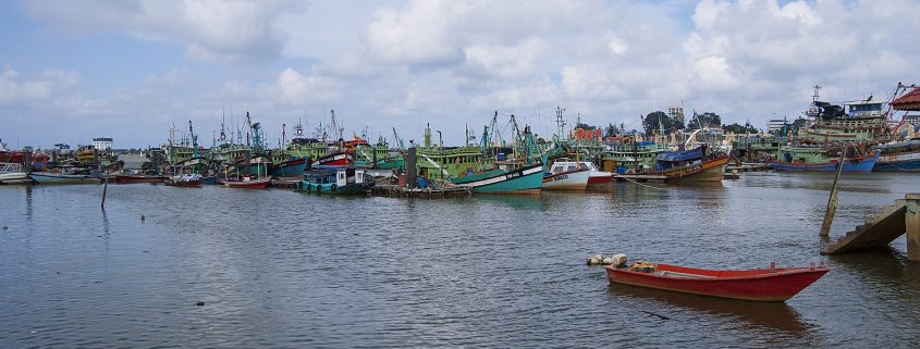 marine coating applied to boats in a harbour in Malaysia